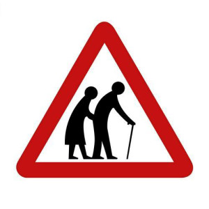 Street sign ELDERLEY PEOPLE CROSSING ( against white background )